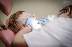 Dentist Performing Procedure